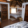 Tabonina Guesthouse - Inside Room 5, Thatched-roof chalet, 2 double beds, ensuite, TV, fridge